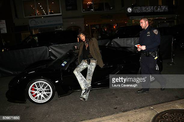 Steven Tyler gets a 'parking ticket' from an NYPD officer at 'Steven TylerOut On A Limb' Kick Off Celebration at Lavo on April 30 2016 in New York...
