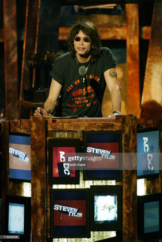 <a gi-track='captionPersonalityLinkClicked' href=/galleries/search?phrase=Steven+Tyler&family=editorial&specificpeople=202080 ng-click='$event.stopPropagation()'>Steven Tyler</a> introduces AC/DC during The 18th Annual Rock and Roll Hall of Fame Induction Ceremony - Show at The Waldorf Astoria in New York City, New York, United States.