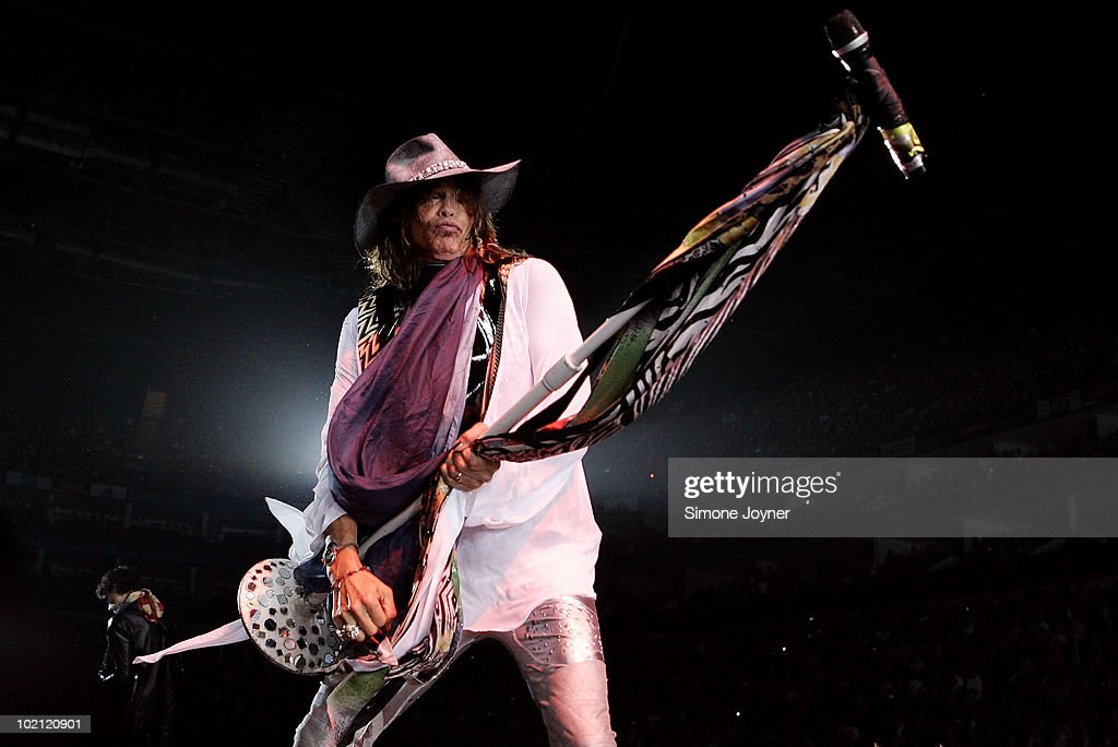 Steven Tyler of Aerosmith performs live on stage as part of their 'Cocked, Locked, Ready To Rock' tour at the O2 Arena on June 15, 2010 in London, England.