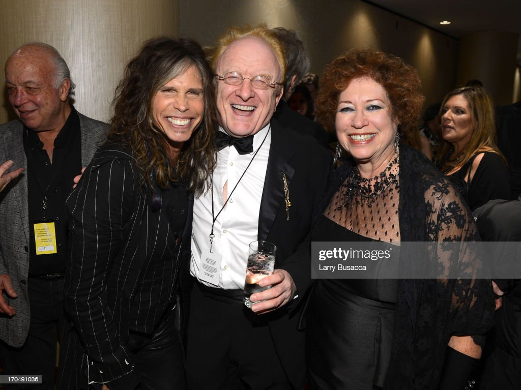 <a gi-track='captionPersonalityLinkClicked' href=/galleries/search?phrase=Steven+Tyler+-+Musician&family=editorial&specificpeople=202080 ng-click='$event.stopPropagation()'>Steven Tyler</a>, Peter Asher and SHOF Treasurer Karen Sher attend the Songwriters Hall of Fame 44th Annual Induction and Awards Dinner at the New York Marriott Marquis on June 13, 2013 in New York City.