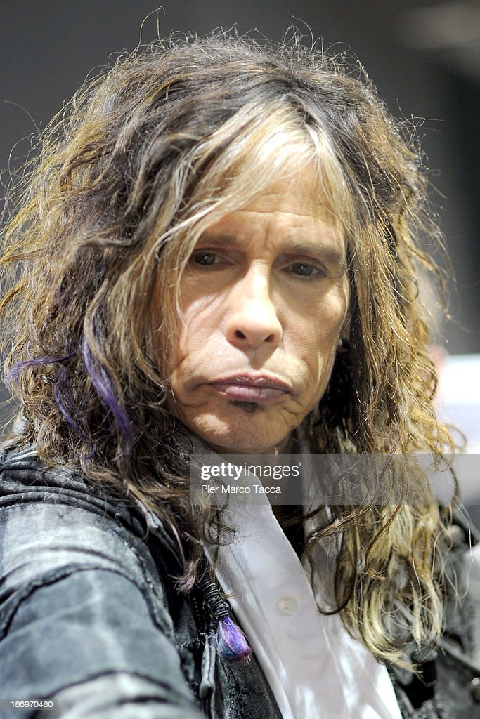 <a gi-track='captionPersonalityLinkClicked' href=/galleries/search?phrase=Steven+Tyler+-+Musician&family=editorial&specificpeople=202080 ng-click='$event.stopPropagation()'>Steven Tyler</a> singer leader of Aerosmith attends Dirico motor presentation during the EICMA 2013 71st International Motorcycle Exhibition on November 5, 2013 in Milan, Italy.