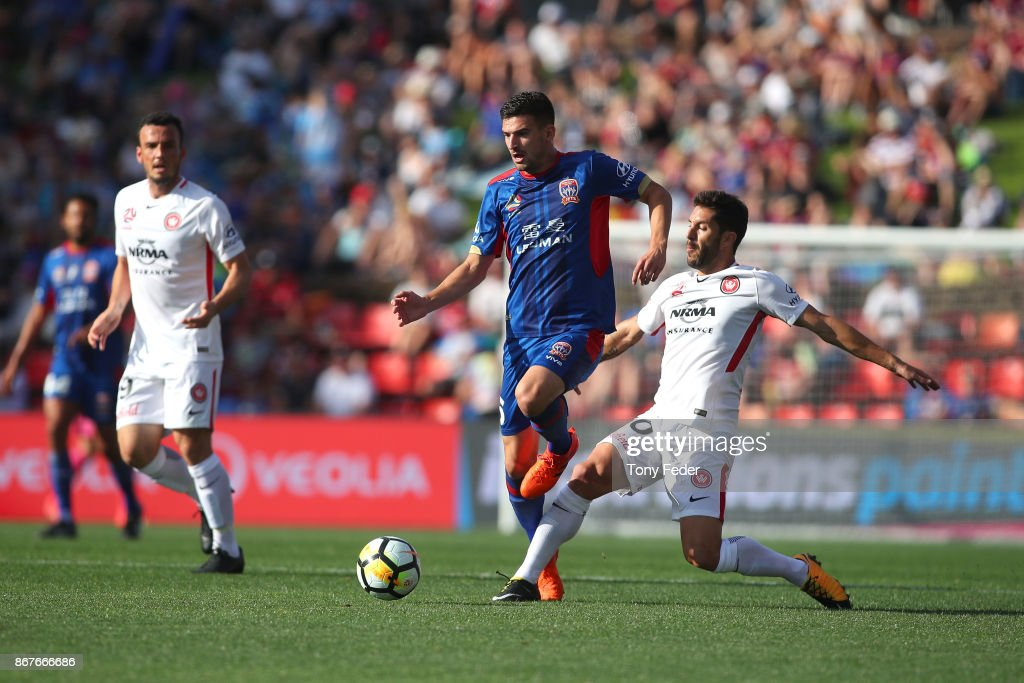 Steven Ugarkovic of the Jets contests the ball with Alvaro Cejudo of the Wanderers during the round four A-League match between the Newcastle Jets and the Western Sydney Wanderers at McDonald Jones Stadium on October 29, 2017 in Newcastle, Australia.