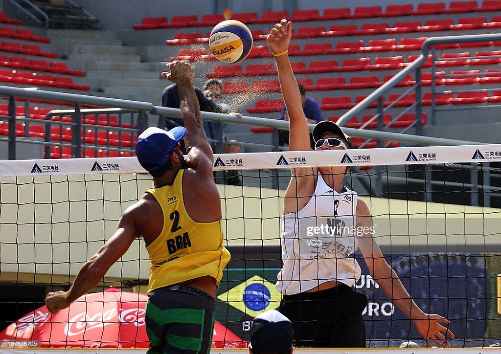 Steven van de Velde (R) of The Netherlands defends against Pedro Solberg Salgado of Brazil during the men's main draw of FIVB Beach Volleyball Shanghai Grand Slam at Jinshan City Beach on May 1, 2013 in Shanghai, China.
