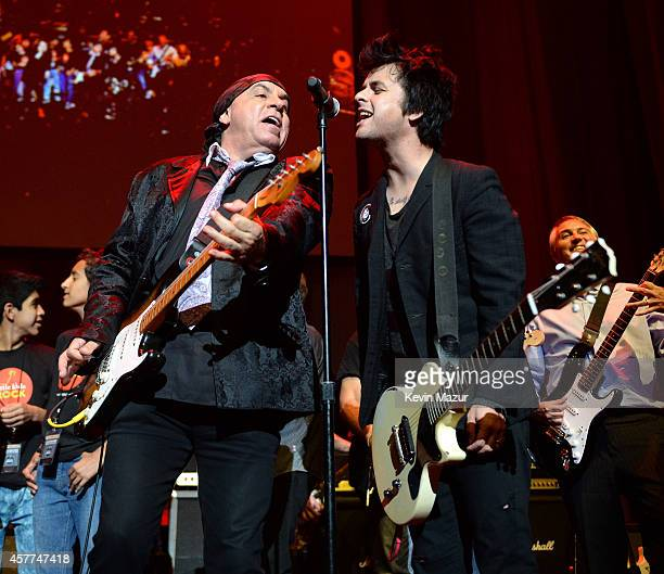 Steven Van Zandt and Billie Joe Armstrong perform onstage during The 6th Annual Little Kids Rock Benefit at Hammerstein Ballroom on October 23 2014...