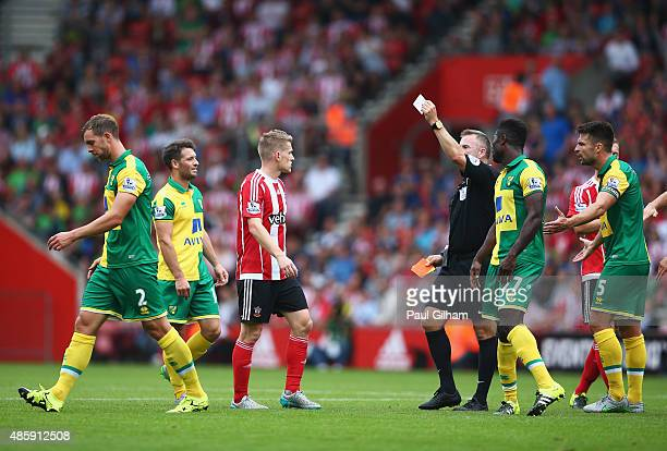 Steven Whittaker of Norwich City leaves the field after being sent off by referee Jonathan Moss during the Barclays Premier League match between...