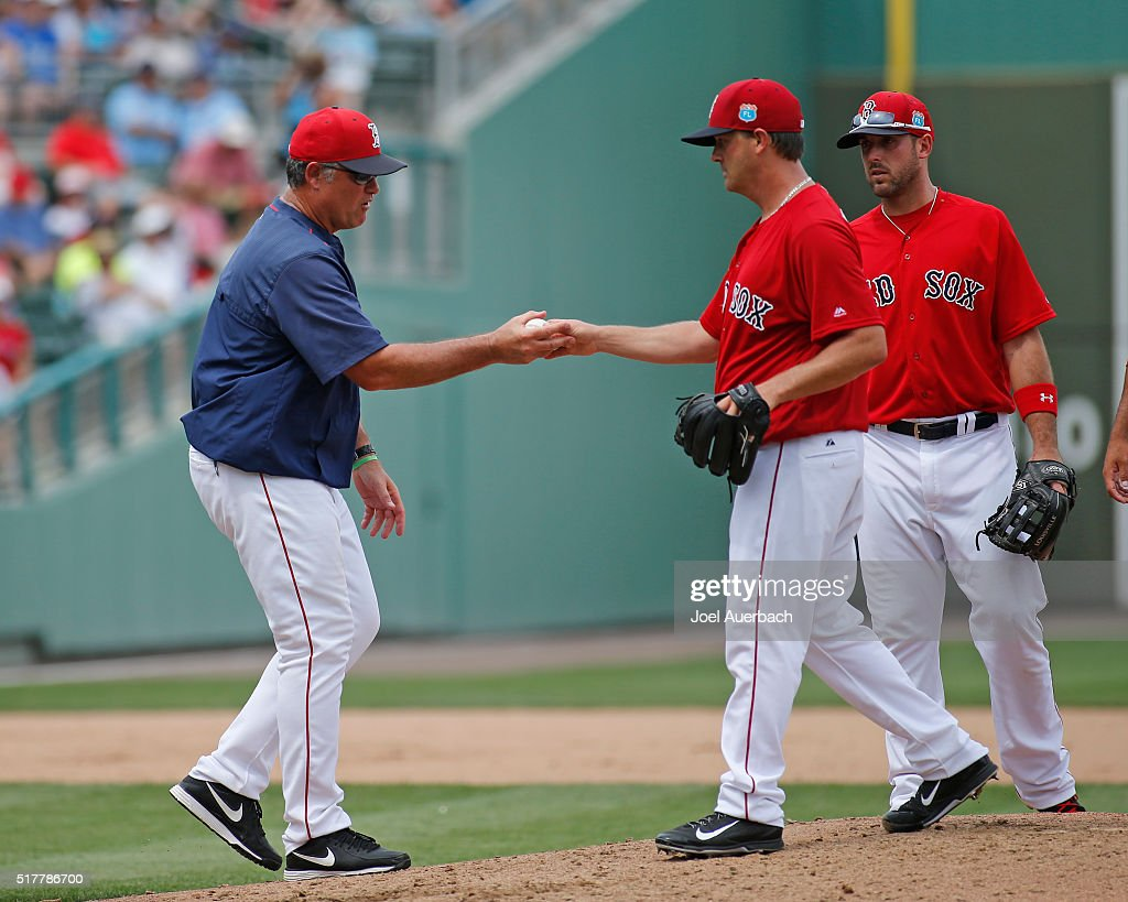 Steven Wright #35 hands the ball to manager John Farrell #53 of the Boston Red Sox as he is taken out of the game against the Philadelphia Phillies during the sixth inning of a spring training game at JetBlue Park on March 27, 2016 in Fort Myers, Florida. The Red Sox defeated the Phillies 5-1.