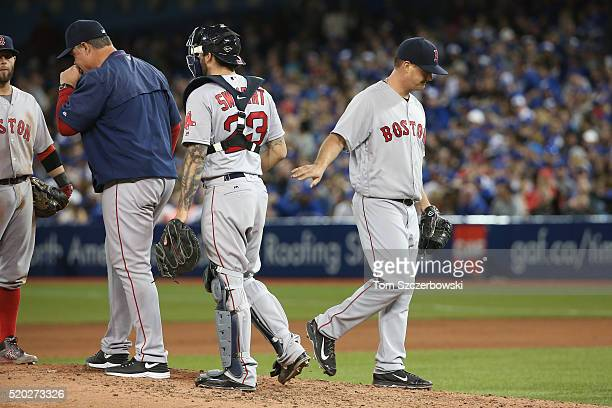 Steven Wright of the Boston Red Sox is relieved by manager John Farrell in the seventh inning during MLB game action against the Toronto Blue Jays on...