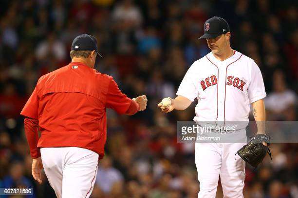 Steven Wright of the Boston Red Sox is taken out of the game by manager John Farrell in the second inning of a game against the Baltimore Orioles at...
