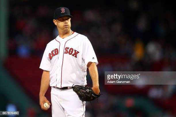 Steven Wright of the Boston Red Sox looks on in the first inning of a game against the Baltimore Orioles at Fenway Park on April 12 2017 in Boston...