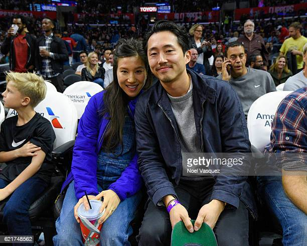 Steven Yeun and Joana Pak attend a basketball game between the Detroit Pistons and the Los Angeles Clippers at Staples Center on November 7 2016 in...