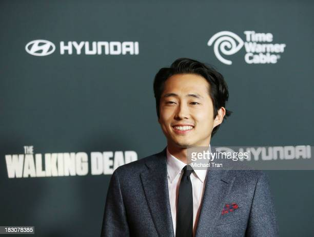 Steven Yeun arrives at the Los Angeles premiere of AMC's 'The Walking Dead' 4th season held at Universal CityWalk on October 3 2013 in Universal City...