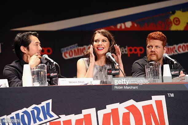 Steven Yeun Lauren Cohan and Michael Cudlitz speak at 'The Walking Dead' NY Comic Con Panel on October 11 2014 in New York City