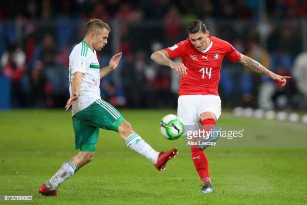 Steven Zubar of Switzerland is closed down by Jamie Ward of Northern Ireland during the FIFA 2018 World Cup Qualifier PlayOff Second Leg between...