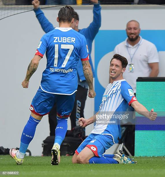 Steven Zuber and Mark Uth of TSG 1899 Hoffenheim celebrate after scoring the 21 during the Bundesliga match between 1899 Hoffenheim and Hertha BSC on...