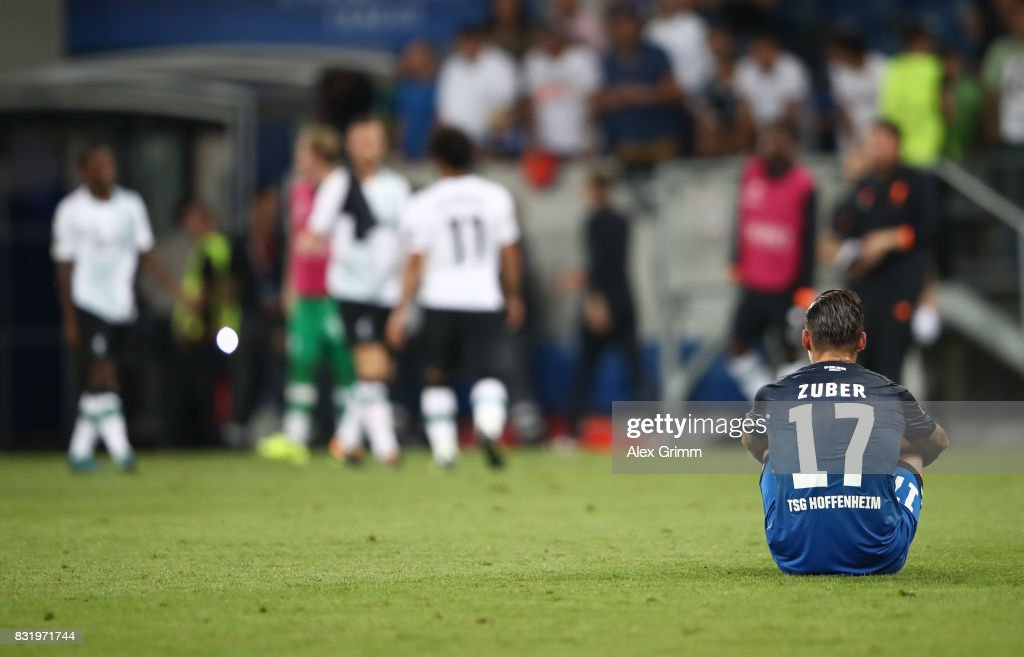 Steven Zuber hot Hoffenheim sits on the pitch after the UEFA Champions League Qualifying Play-Offs Round First Leg match between 1899 Hoffenheim and Liverpool FC at Wirsol Rhein-Neckar-Arena on August 15, 2017 in Sinsheim, Germany.
