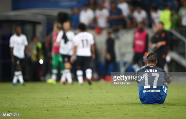 Steven Zuber hot Hoffenheim sits on the pitch after the UEFA Champions League Qualifying PlayOffs Round First Leg match between 1899 Hoffenheim and...