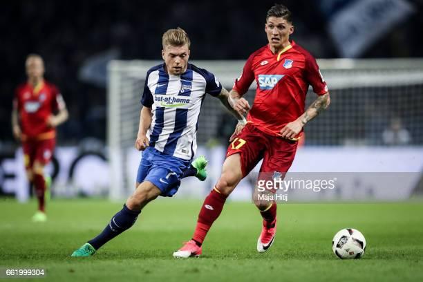 Steven Zuber of Hoffenheim and Alexander Esswein of Berlin battle for the ball during the Bundesliga match between Hertha BSC and TSG 1899 Hoffenheim...