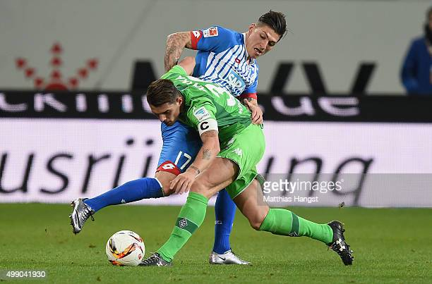 Steven Zuber of Hoffenheim and Granit Xhaka of Gladbach compete for the ball during the Bundesliga match between 1899 Hoffenheim and Borussia...