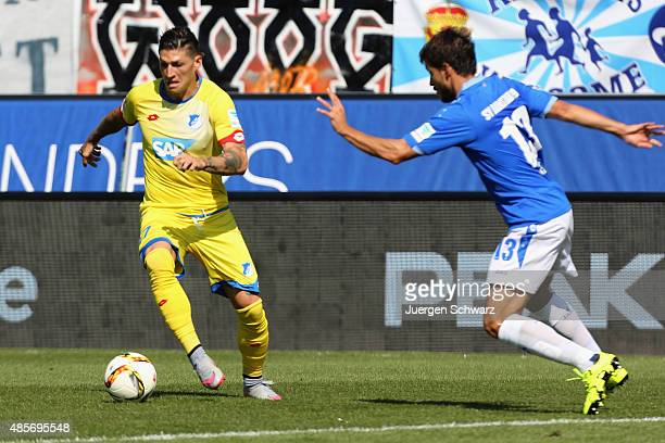 Steven Zuber of Hoffenheim and Gyoergy Garics of Darmstadt fight for the ball during the Bundesliga match between SV Darmstadt 98 and 1899 Hoffenheim...