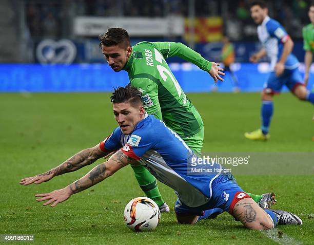 Steven Zuber of Hoffenheim and Julian Korb of Gladbach compete for the ball during the Bundesliga match between 1899 Hoffenheim and Borussia...