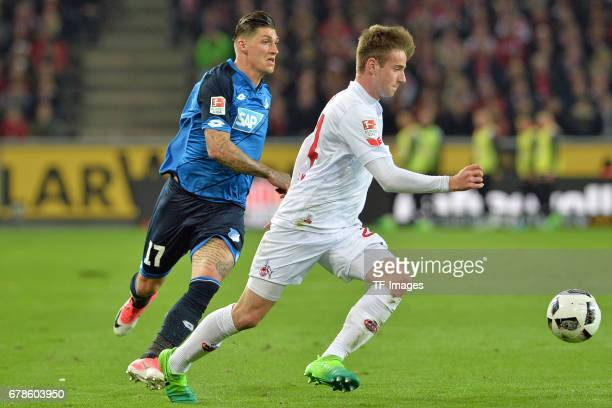 Steven Zuber of Hoffenheim and Lukas Klünter of Koeln battle for the ball during the Bundesliga match between 1 FC Koeln and TSG 1899 Hoffenheim at...