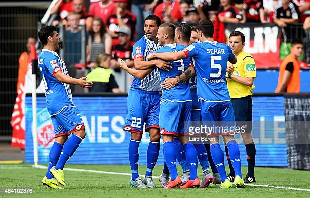 Steven Zuber of Hoffenheim celebrates with team mates after scoring his teams first goal during the Bundesliga match between Bayer Leverkusen and...