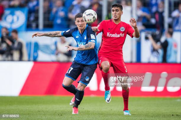 Steven Zuber of Hoffenheim is challenged by Aymane Barkok of Frankfurt during the Bundesliga match between TSG 1899 Hoffenheim and Eintracht...