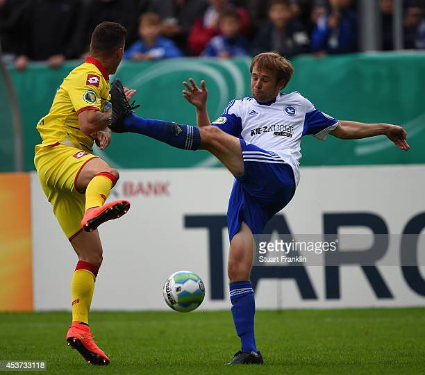 Steven Zuber of Hoffenheim is challenged by Jan Kramer of Paloma during the DFB Pokal first round match between USC Paloma and 1899 Hoffenheim on...