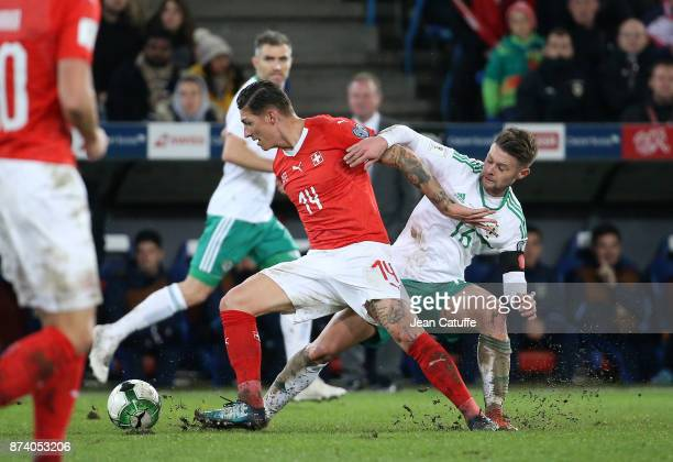 Steven Zuber of Switzerland Oliver Norwood of Northern Ireland during the FIFA 2018 World Cup Qualifier PlayOff Second Leg between Switzerland and...