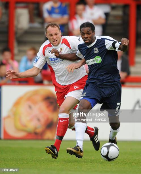 Stevenage Borough's Charlie Griffin and Southend United's Anthony Grant