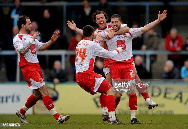Stevenage Borough's John Mousinho celebrates with team mates after scoring the opening goal of the game during the npower Football League Two match...