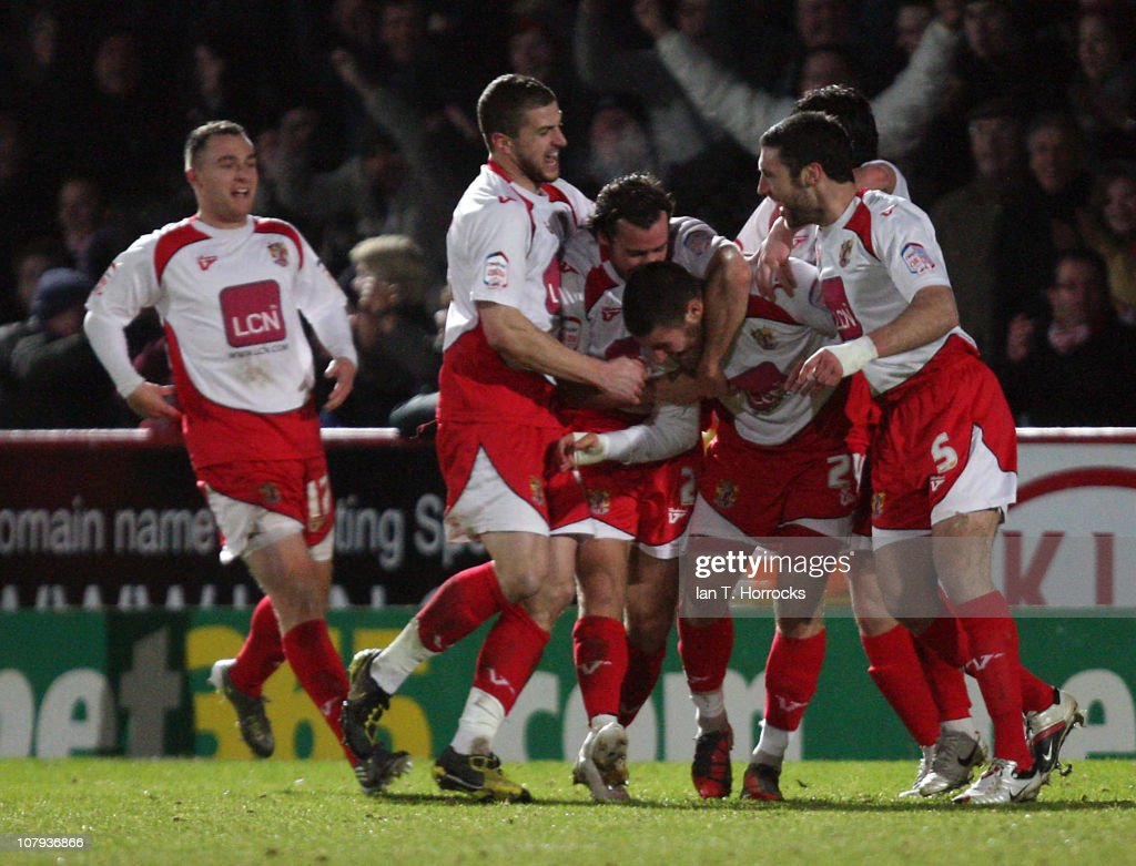 Stevenage players surround Michael Bostwick after he scored the second goal for their team during the FA Cup sponsored by EON 3rd round match between...
