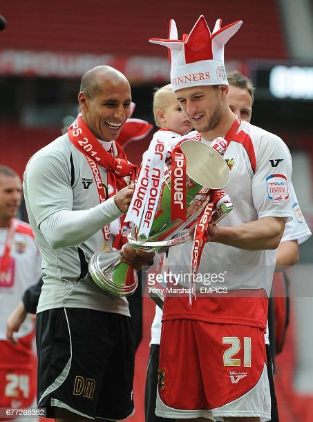Stevenage's First Team Coach Dino Maamria and John Mousinho celebrate with the trophy after gaining promotion into League One