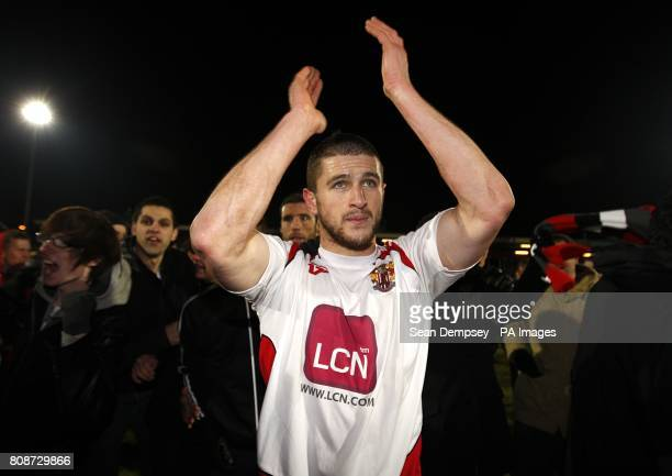 Stevenage's John Mousinho celebrates victory after the final whistle