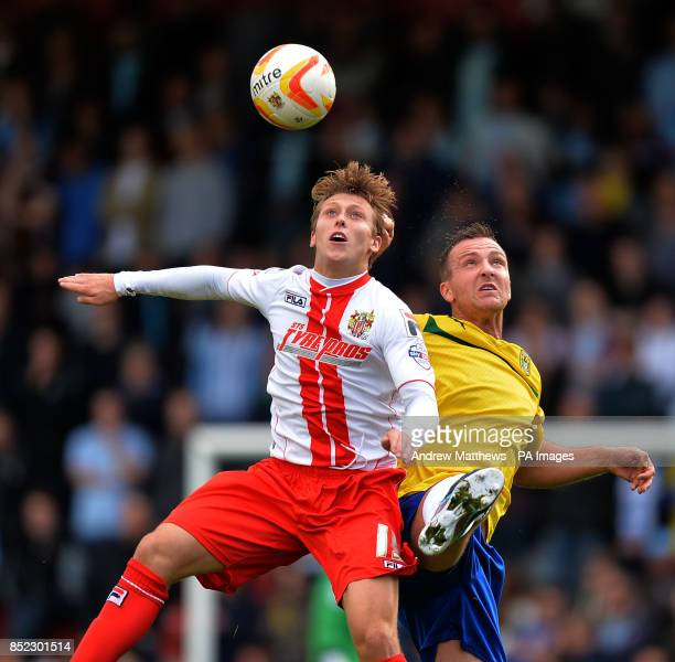Stevenage's Luke Freeman and Coventry City's Andy Webster battle for the ball during to the Sky Bet League One match at the Lamex Stadium Stevenage