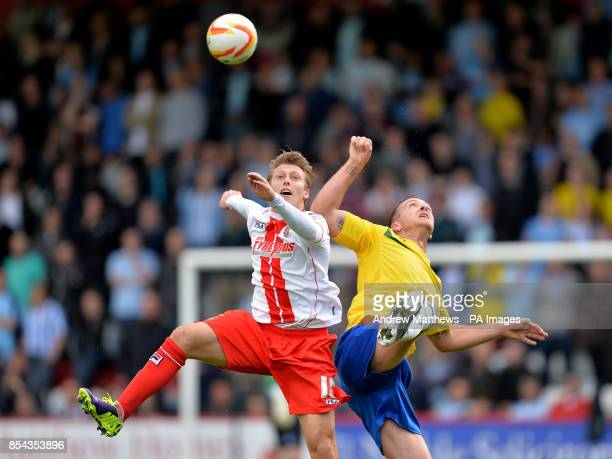 Stevenage's Luke Freeman and Coventry City's Andy Webster battle for the ball in the air