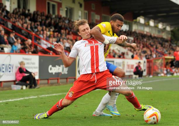 Stevenage's Luke Freeman and Coventry City's Cyrus Christie battle for the ball