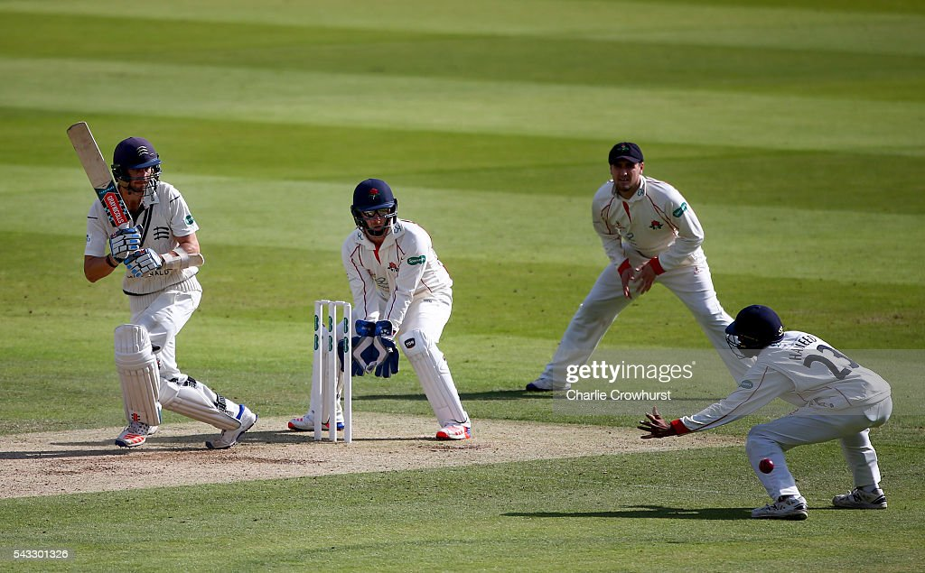 Stevie Eskinazi of Middlesex hits out while Steven Croft of Lancashire looks on as Haseeb Hameed fails to stop the ball duriung day two of the Specsavers County Championship division one match between Midlesex and Lancashire at Lords on June 27, 2016 in London, England.
