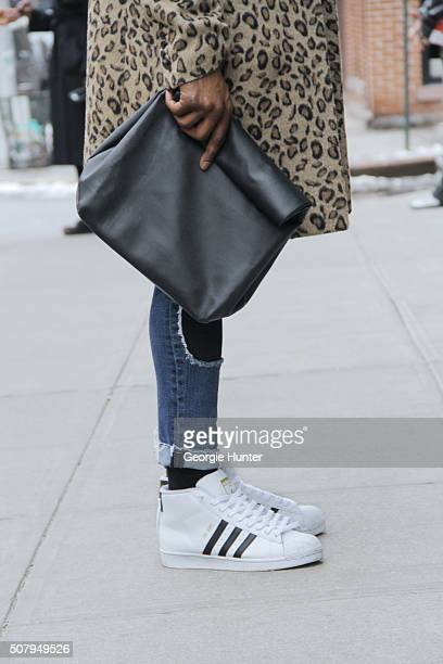 Stevie Gatez seen at Industria Superstudios wearing black and white Adidas sneakers ripped Topman denim jeans Nick Grimshaw for Topman leopard print...