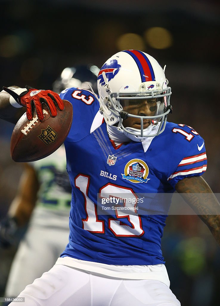 Stevie Johnson #13 of the Buffalo Bills spikes the football to celebrate his touchdown during an NFL game against the Seattle Seahawks at Rogers Centre on December 16, 2012 in Toronto, Ontario, Canada.