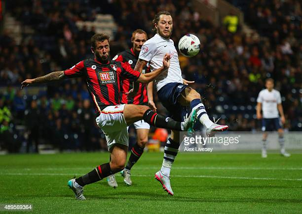 Stevie May of Preston North End and Steve Cook of Bournemouth battle for the abll during the Capital One Cup third round match between Preston North...