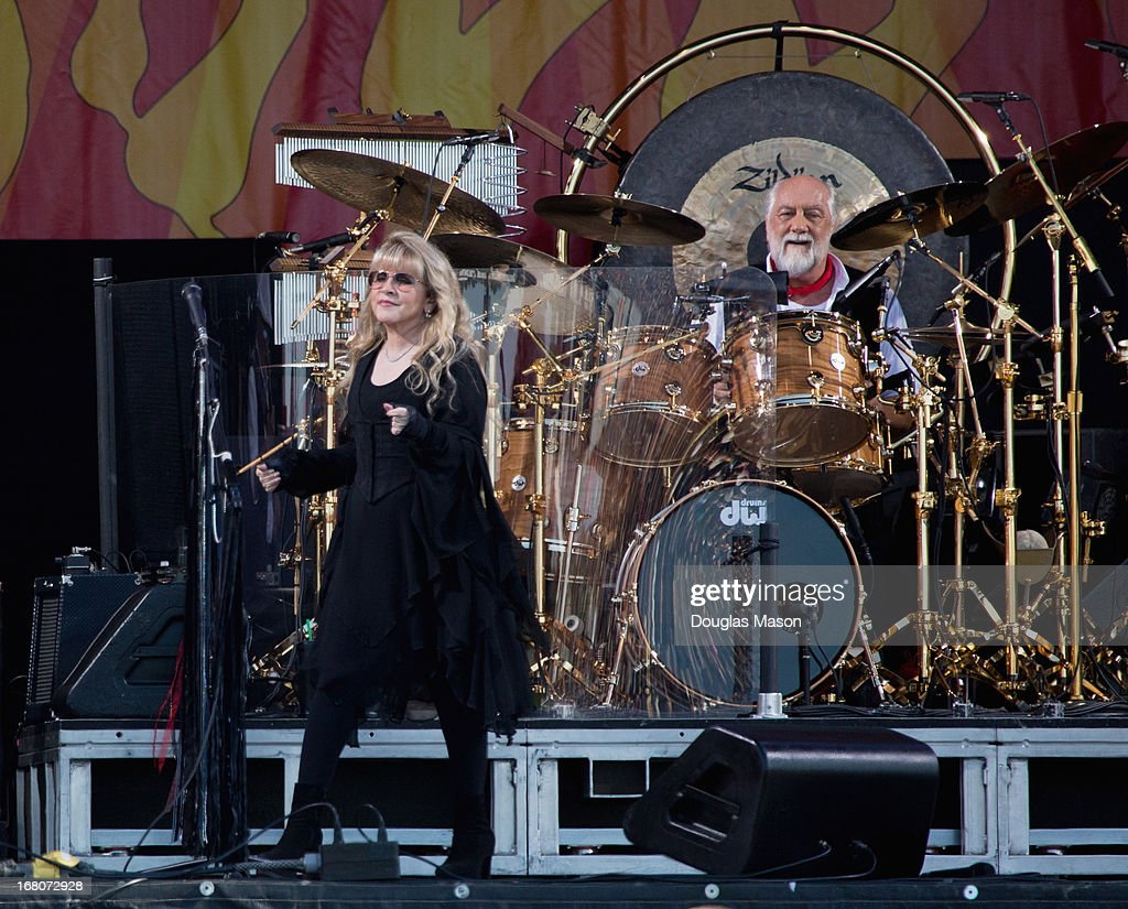 <a gi-track='captionPersonalityLinkClicked' href=/galleries/search?phrase=Stevie+Nicks&family=editorial&specificpeople=212751 ng-click='$event.stopPropagation()'>Stevie Nicks</a> and Mic Fleetwood of Fleetwood Mac performs during the 2013 New Orleans Jazz & Heritage Music Festival at Fair Grounds Race Course on May 4, 2013 in New Orleans, Louisiana.