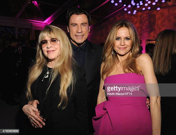 Stevie Nicks John Travolta and Kelly Preston attend the 2014 Vanity Fair Oscar Party Hosted By Graydon Carter on March 2 2014 in West Hollywood...