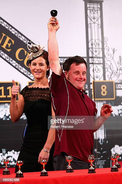 Stevie Payne reacts as Michelle Payne gestures during the 2015 Melbourne Cup Barrier Draw at Flemington Racecourse on October 31 2015 in Melbourne...