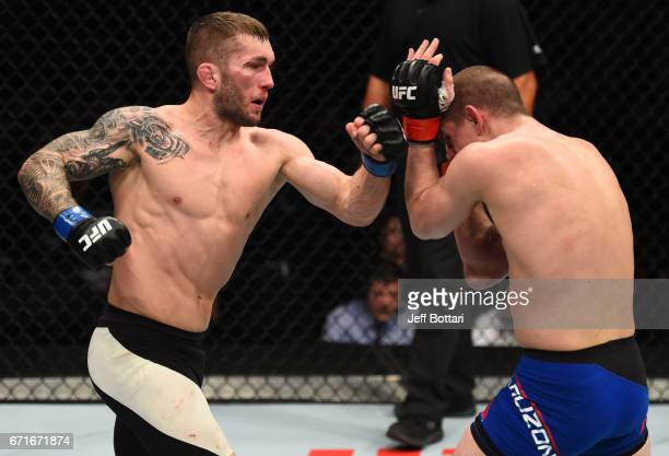 Stevie Ray of Scotland punches Joe Lauzon in their lightweight bout during the UFC Fight Night event at Bridgestone Arena on April 22 2017 in...