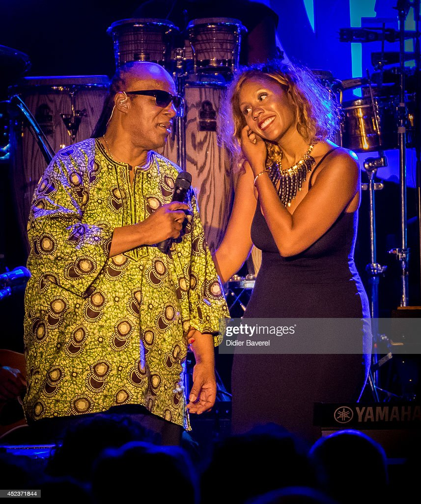 Stevie wonder and his daughter aisha morris perform on stage at the