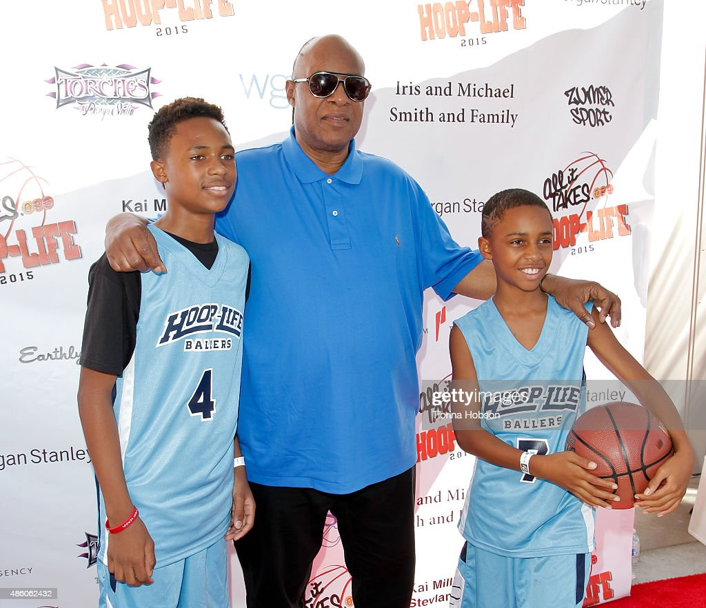 Stevie Wonder (C) and his sons Kailand Morris and Mandla Morris attend the 3rd annual Hoop-Life FriendRaiser at Galen Center on August 30, 2015 in Los Angeles, California.