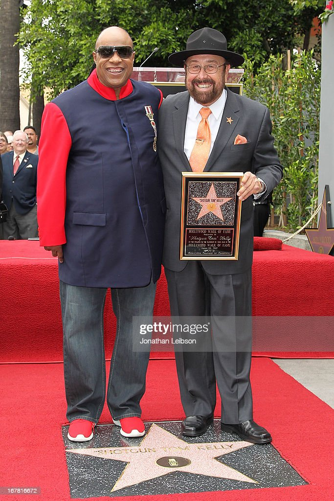 <a gi-track='captionPersonalityLinkClicked' href=/galleries/search?phrase=Stevie+Wonder&family=editorial&specificpeople=171911 ng-click='$event.stopPropagation()'>Stevie Wonder</a> and 'Shotgun Tom' Kelly attend the ceremony honoring 'Shotgun Tom' Kelly with a star on The Hollywood Walk of Fame held on April 30, 2013 in Hollywood, California.