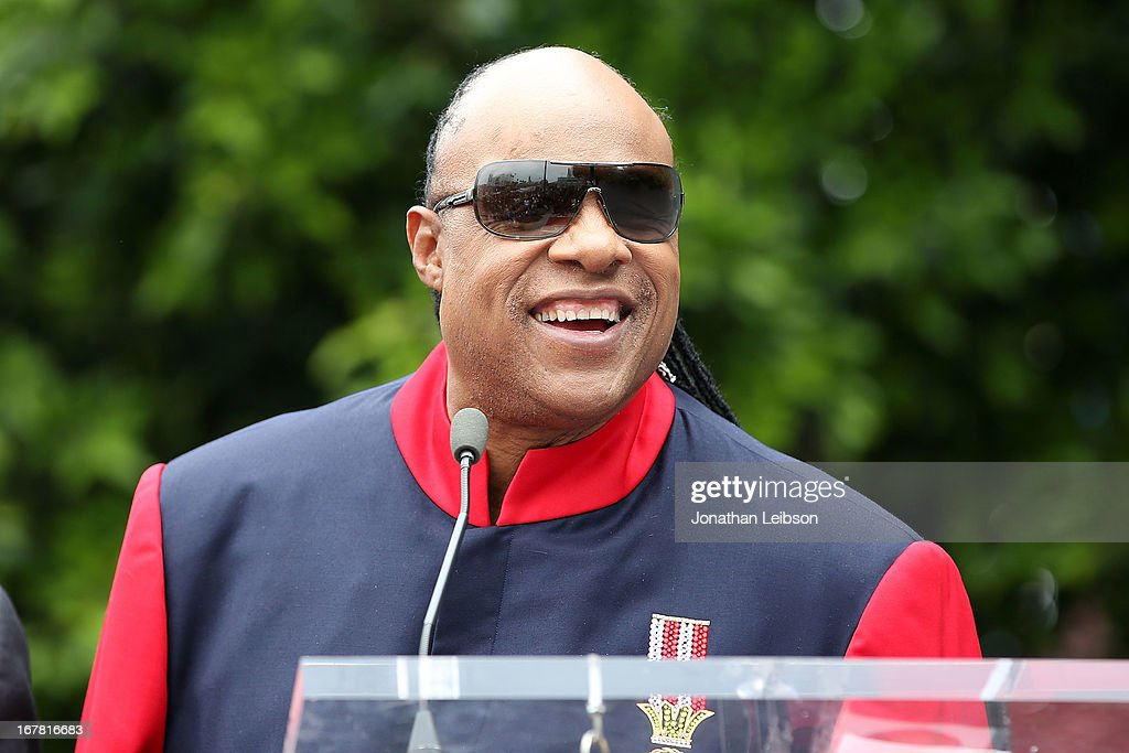 <a gi-track='captionPersonalityLinkClicked' href=/galleries/search?phrase=Stevie+Wonder&family=editorial&specificpeople=171911 ng-click='$event.stopPropagation()'>Stevie Wonder</a> attends the ceremony honoring 'Shotgun Tom' Kelly with a star on The Hollywood Walk of Fame held on April 30, 2013 in Hollywood, California.