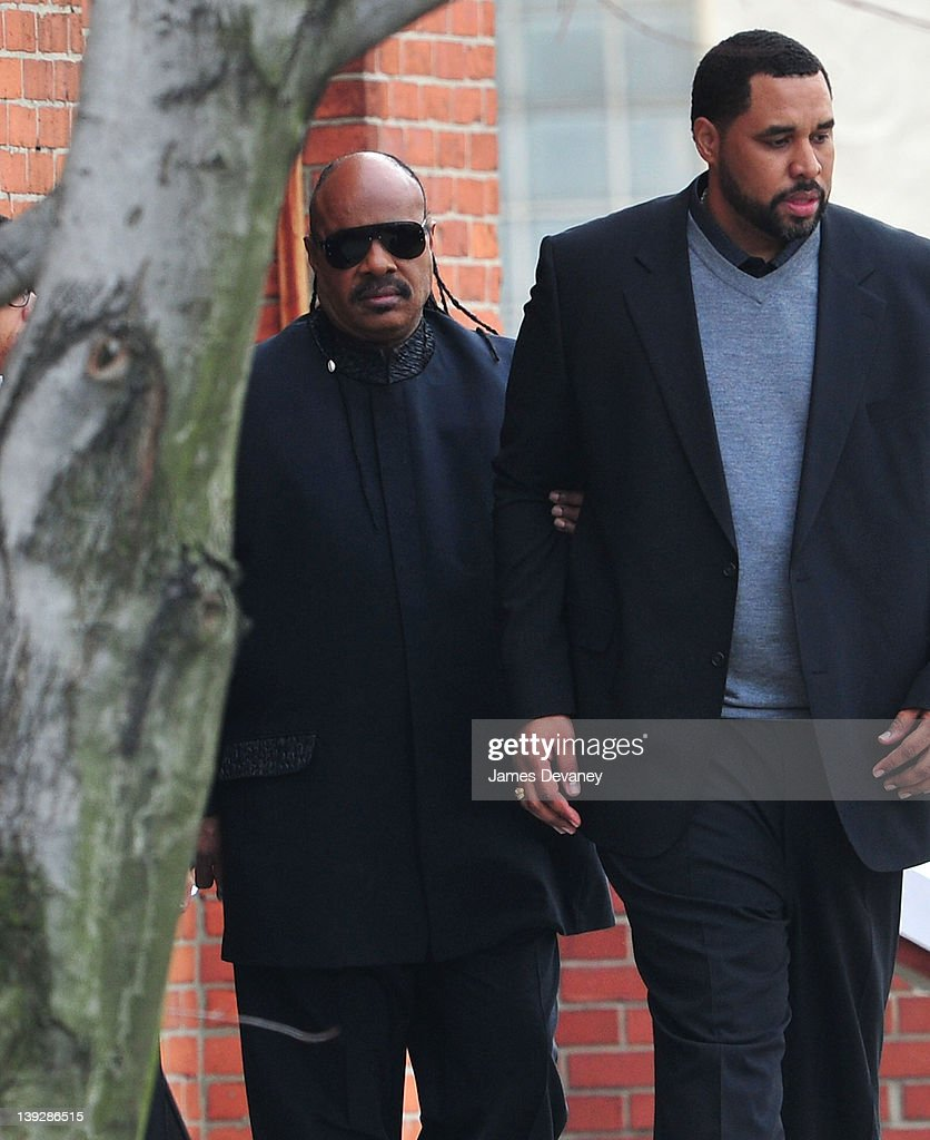 Stevie Wonder (L) leaves the funeral service for Whitney Houston on February 18, 2012 in Newark, New Jersey. Whitney Houston was found dead in her hotel room at The Beverly Hilton hotel on February 11, 2012.
